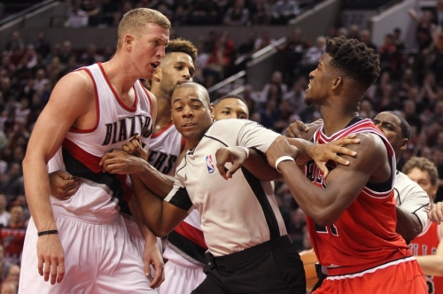 Nov 24, 2015; Portland, OR, USA; Referee Karl Lane (77) separates Portland Trail Blazers center Mason Plumlee (24) and Chicago Bulls guard Jimmy Butler (21) at Moda Center at the Rose Quarter. Mandatory Credit: Jaime Valdez-USA TODAY Sports
